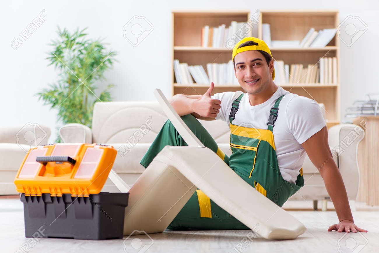 Stock Photo   Worker Repairing Furniture At Home