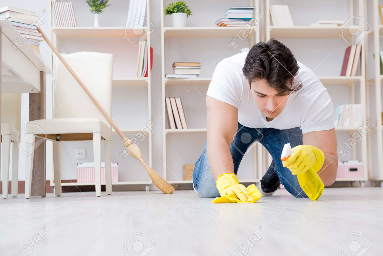 Man Doing Cleaning At Home Stock Photo, Picture And Royalty Free ...