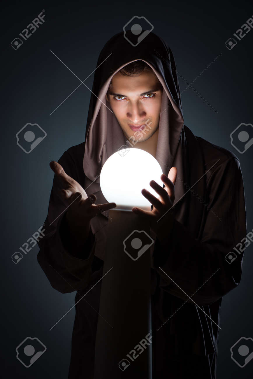 Young Wizard With Crystal Ball In Dark Room Stock Photo, Picture And  Royalty Free Image. Image 88412857.