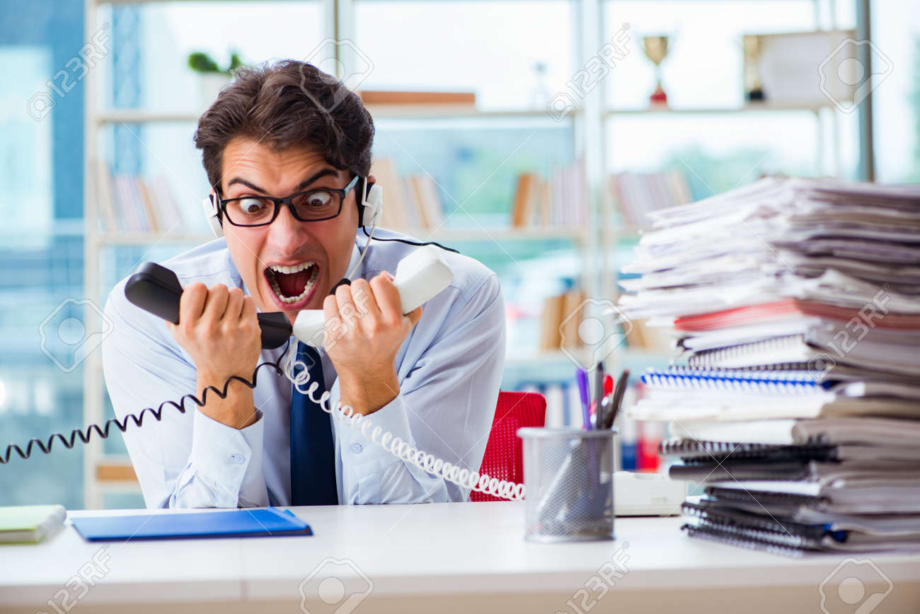 Unhappy angry call center worker frustrated with workload - 91652410