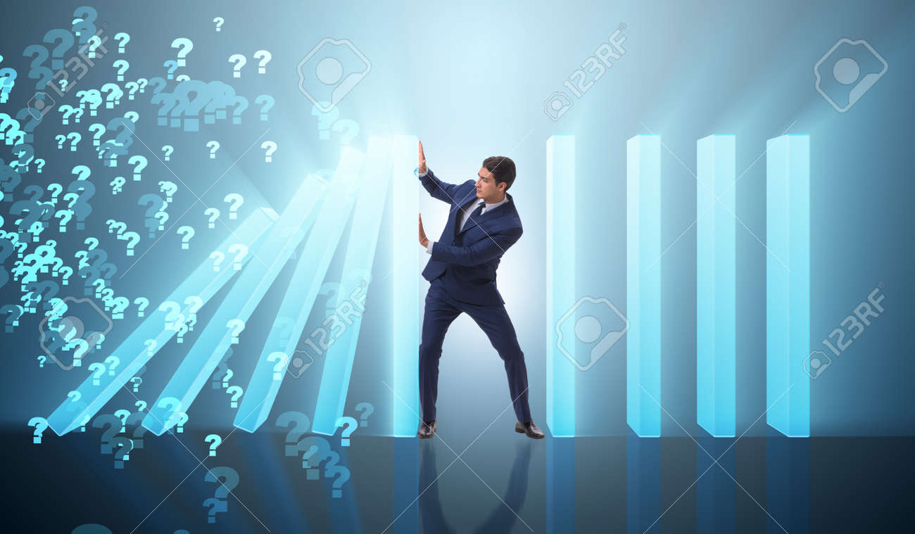 Businessman in domino effect business concept - 93301128