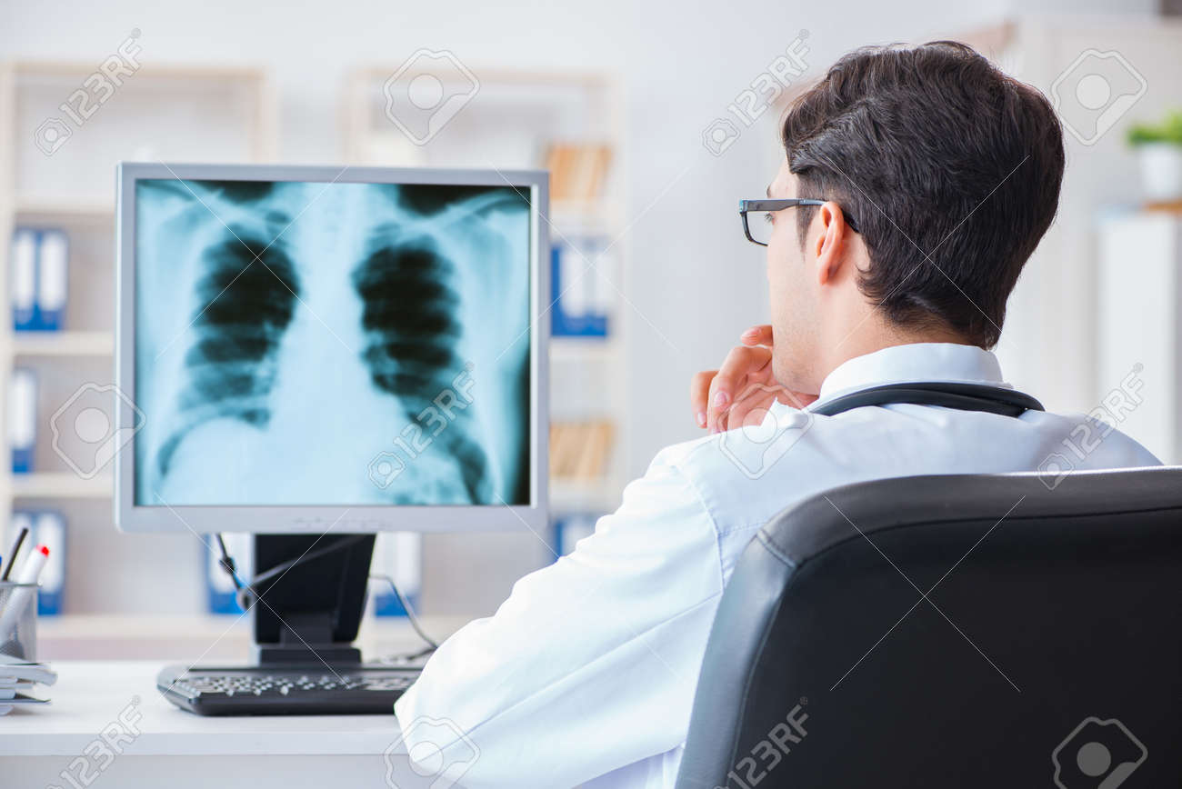 Doctor Radiologist Looking At X Ray Images Stock Photo Picture And