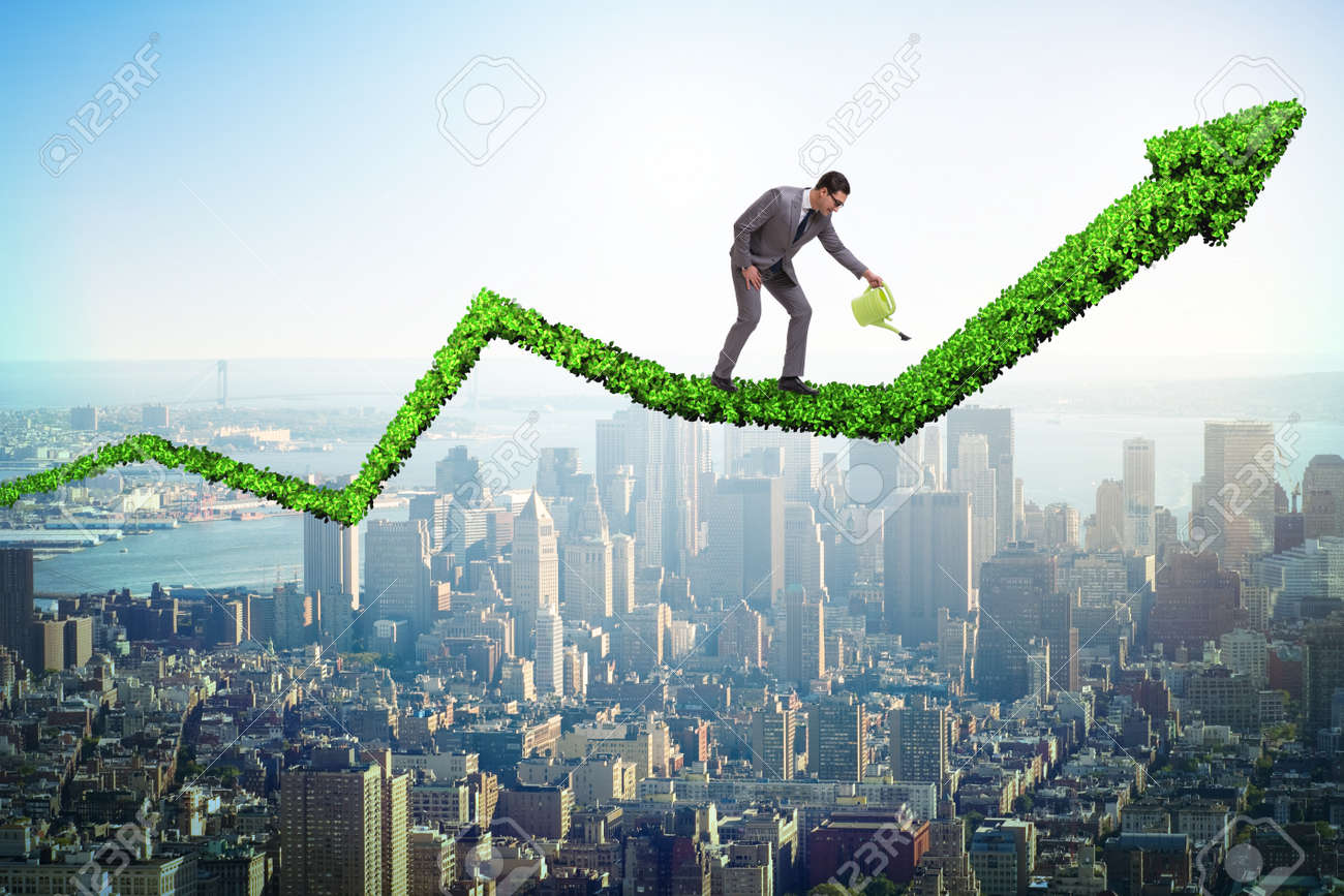 Businessman in investment concept watering financial line chart - 95296392