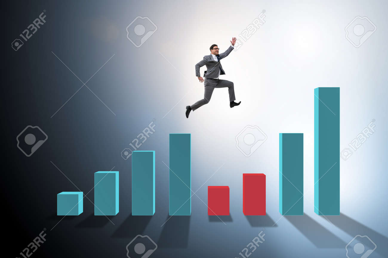 Young businessman in business concept with bar charts - 95296591