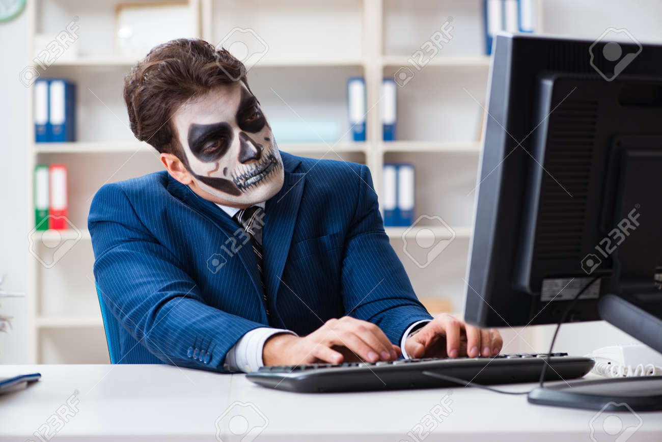 msn office. businessmsn with scary face mask working in office stock photo - 96321556 msn