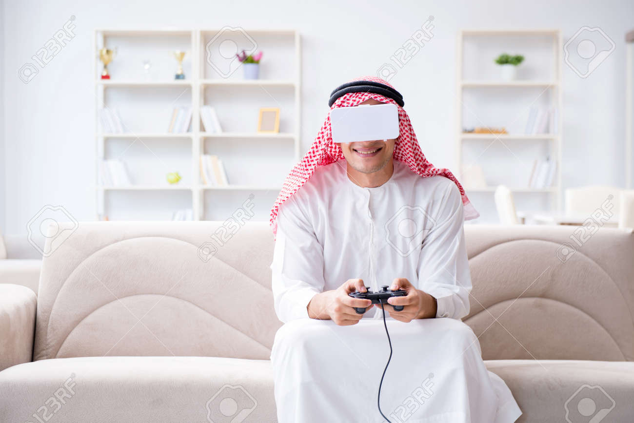 Arab man addicted to video games Stock Photo - 97013215