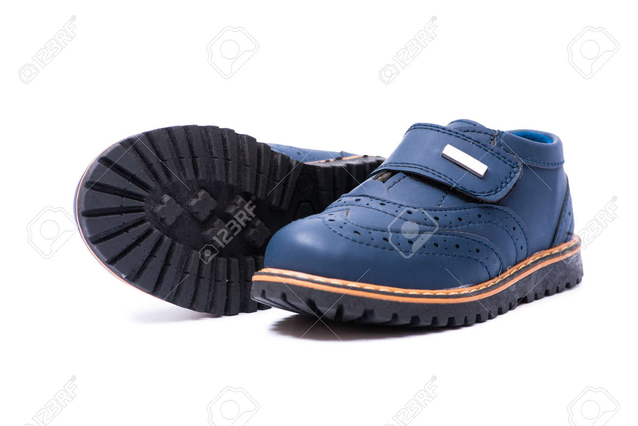 970ac7529 Blue baby shoes isolated on white background Stock Photo - 115522465