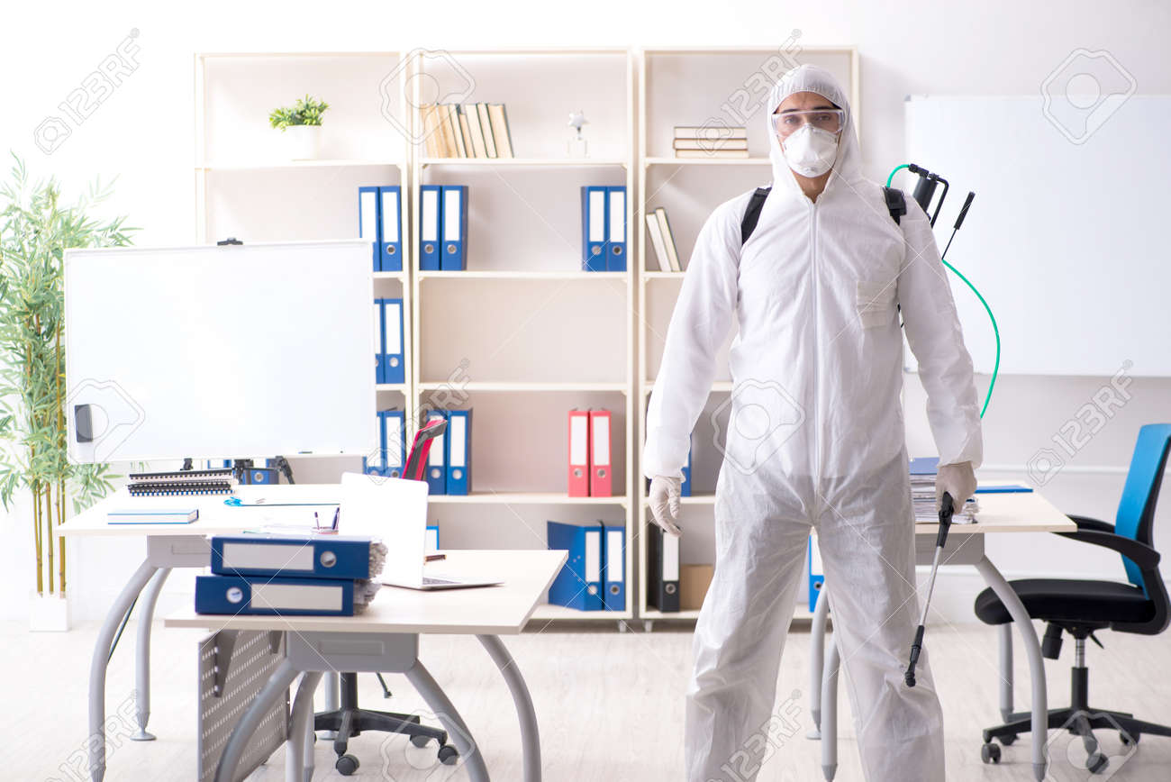 Professional contractor doing pest control at office - 119430824