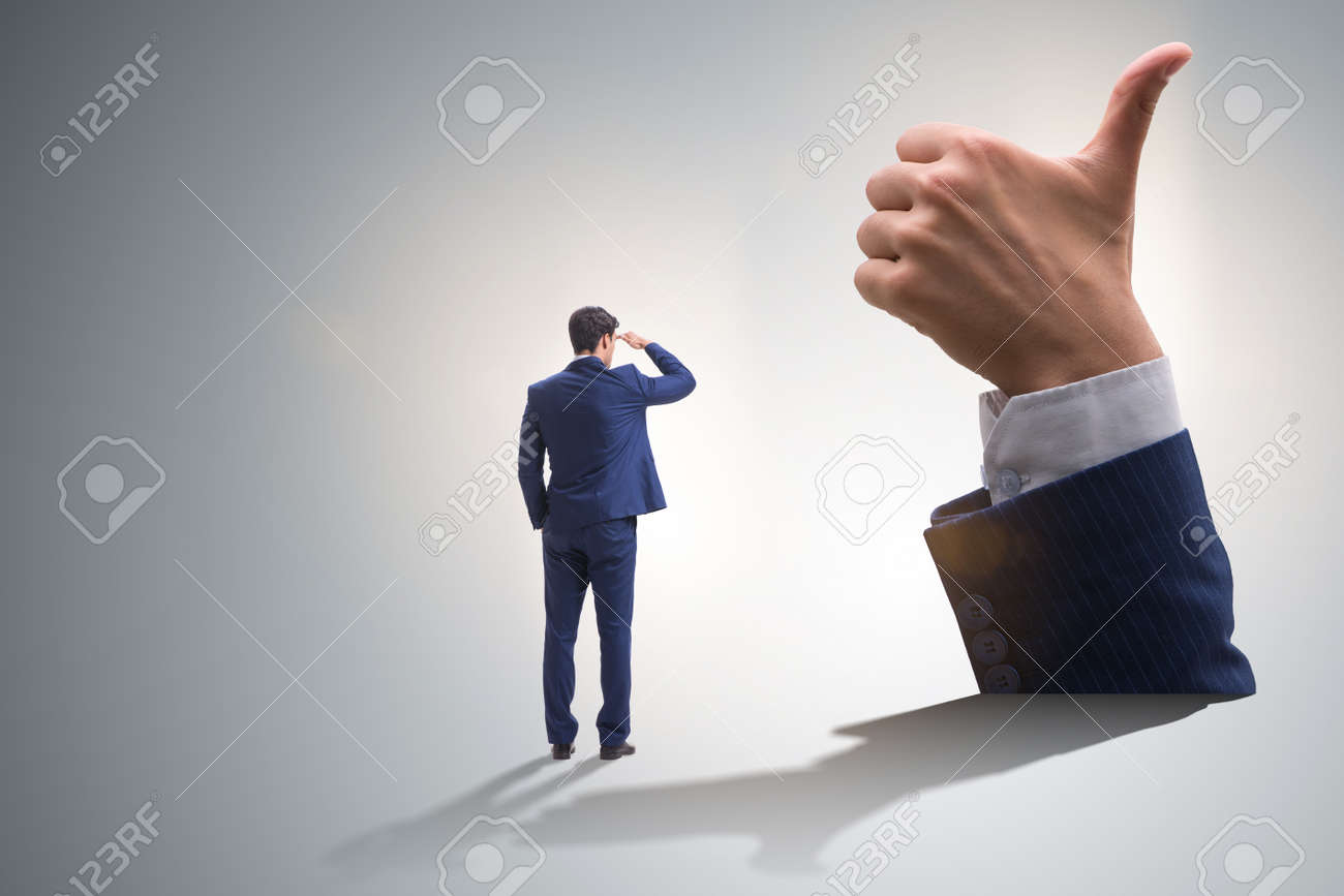 Businessman showing thumbs up gesture - 120794565