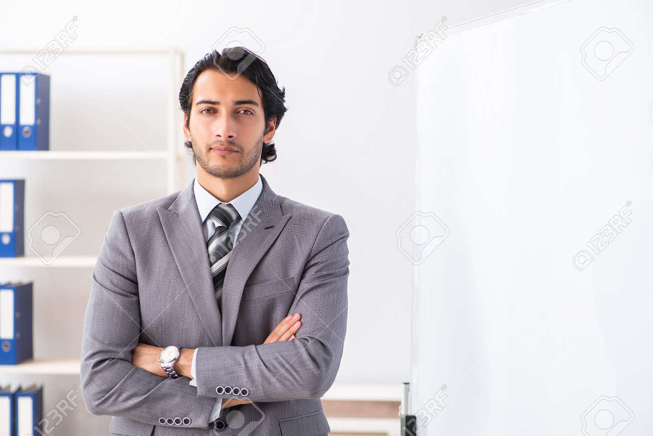Young handsome businessman in front of whiteboard - 121244844