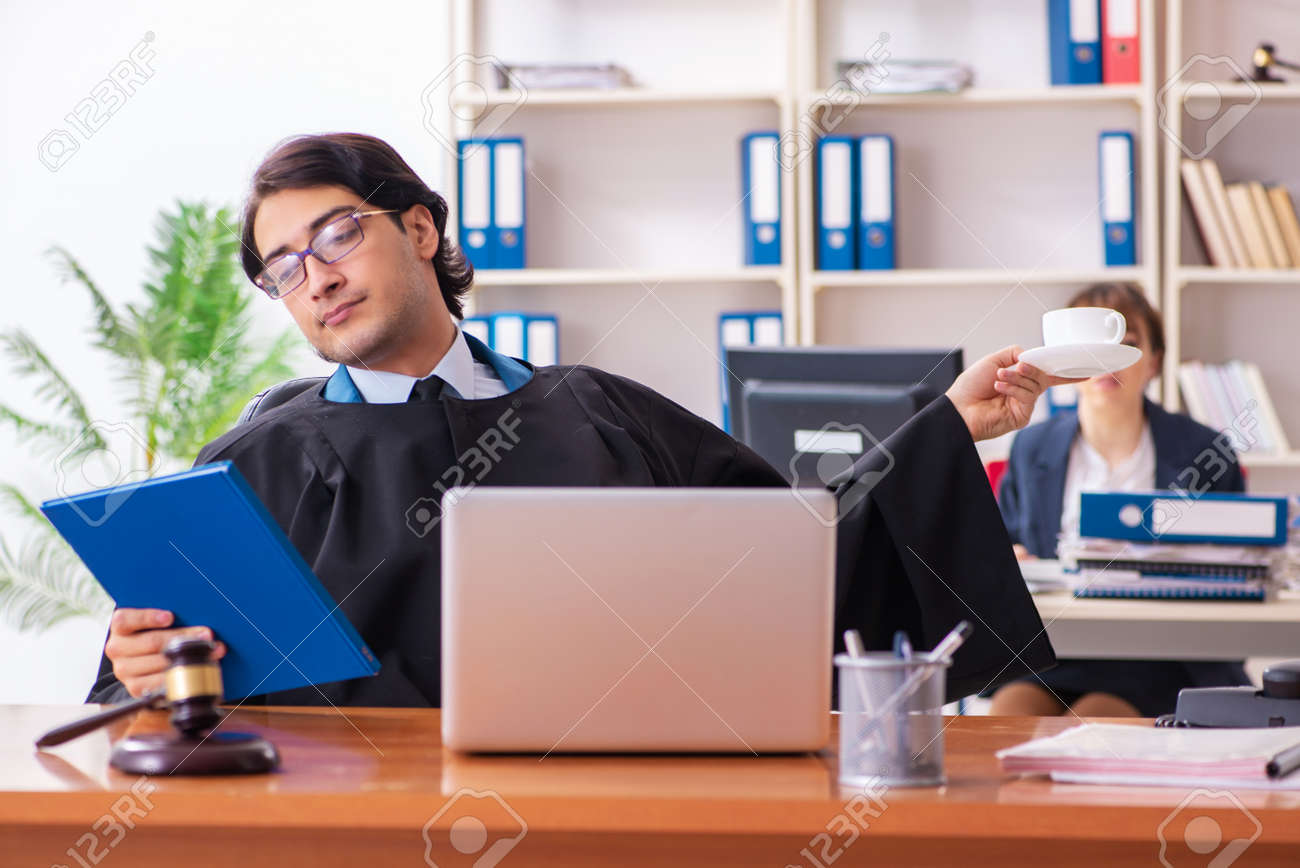 Two lawyers working in the office - 121648799