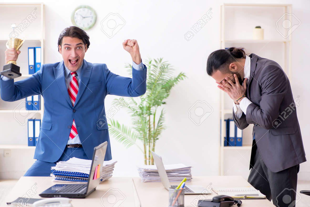Two male colleagues in the office - 124203478