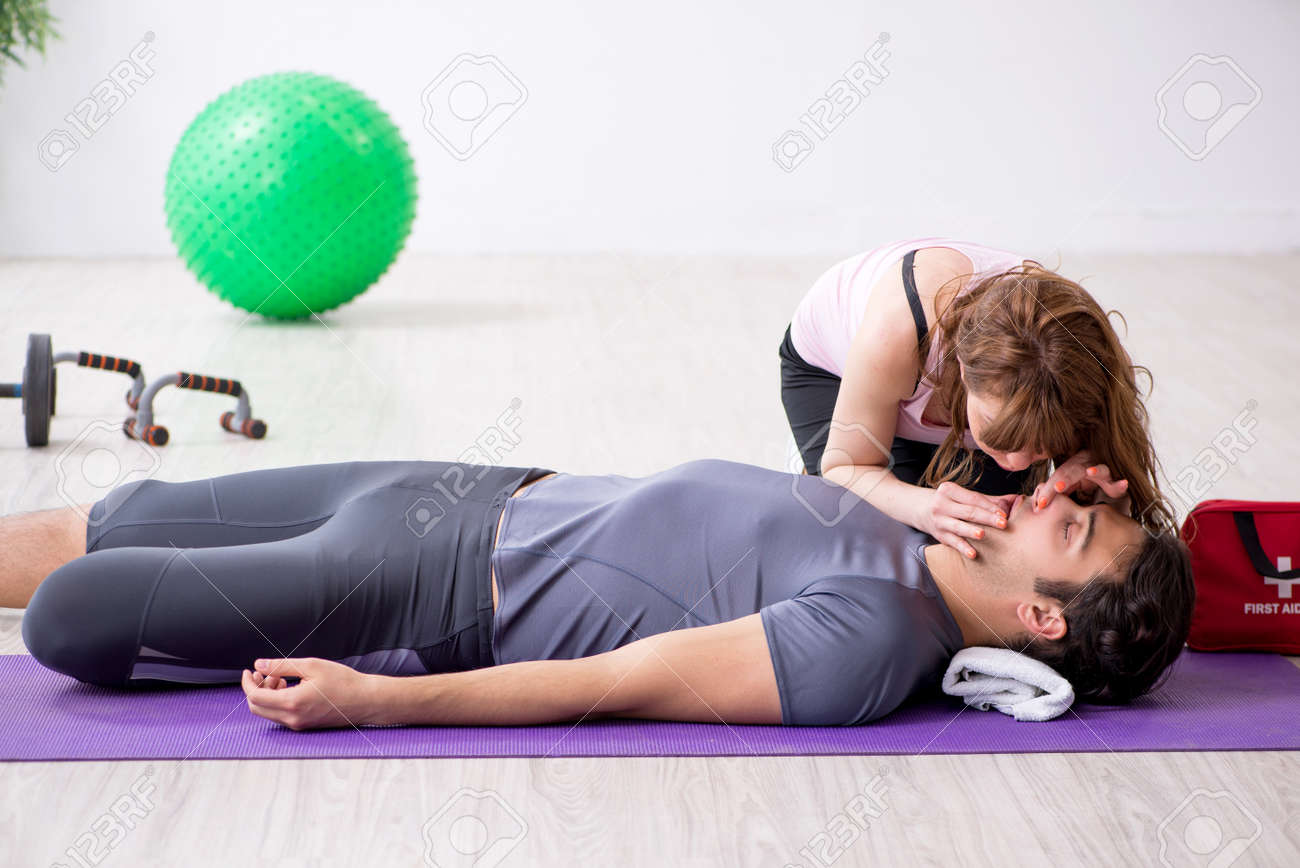 Young man feeling bad during training in first aid concept - 127917099