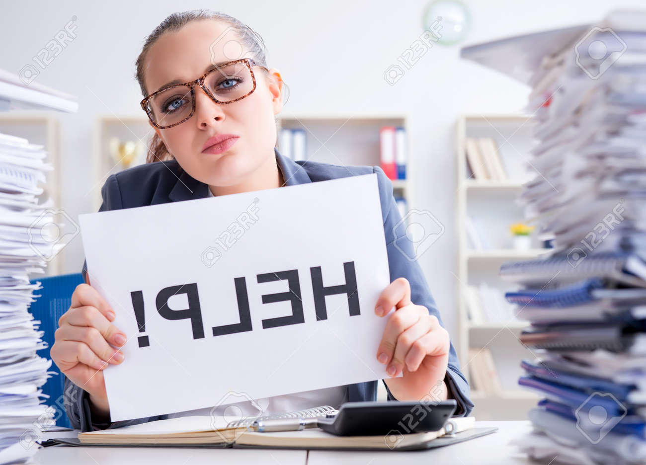 Businesswoman pleading for help in office - 129099795