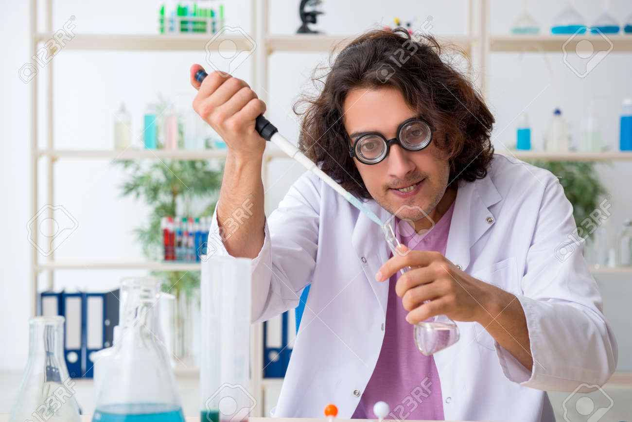 Funny male chemist working in the lab - 130677472