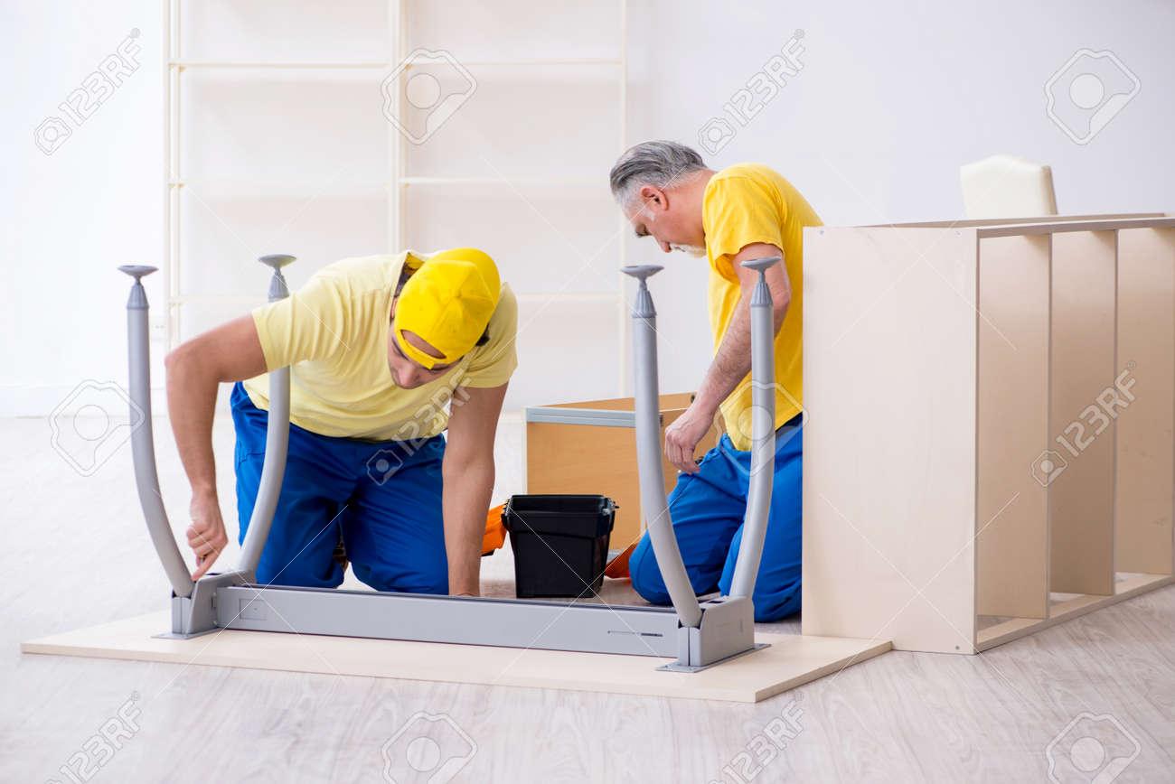 Two contractors carpenters working indoors - 131545059