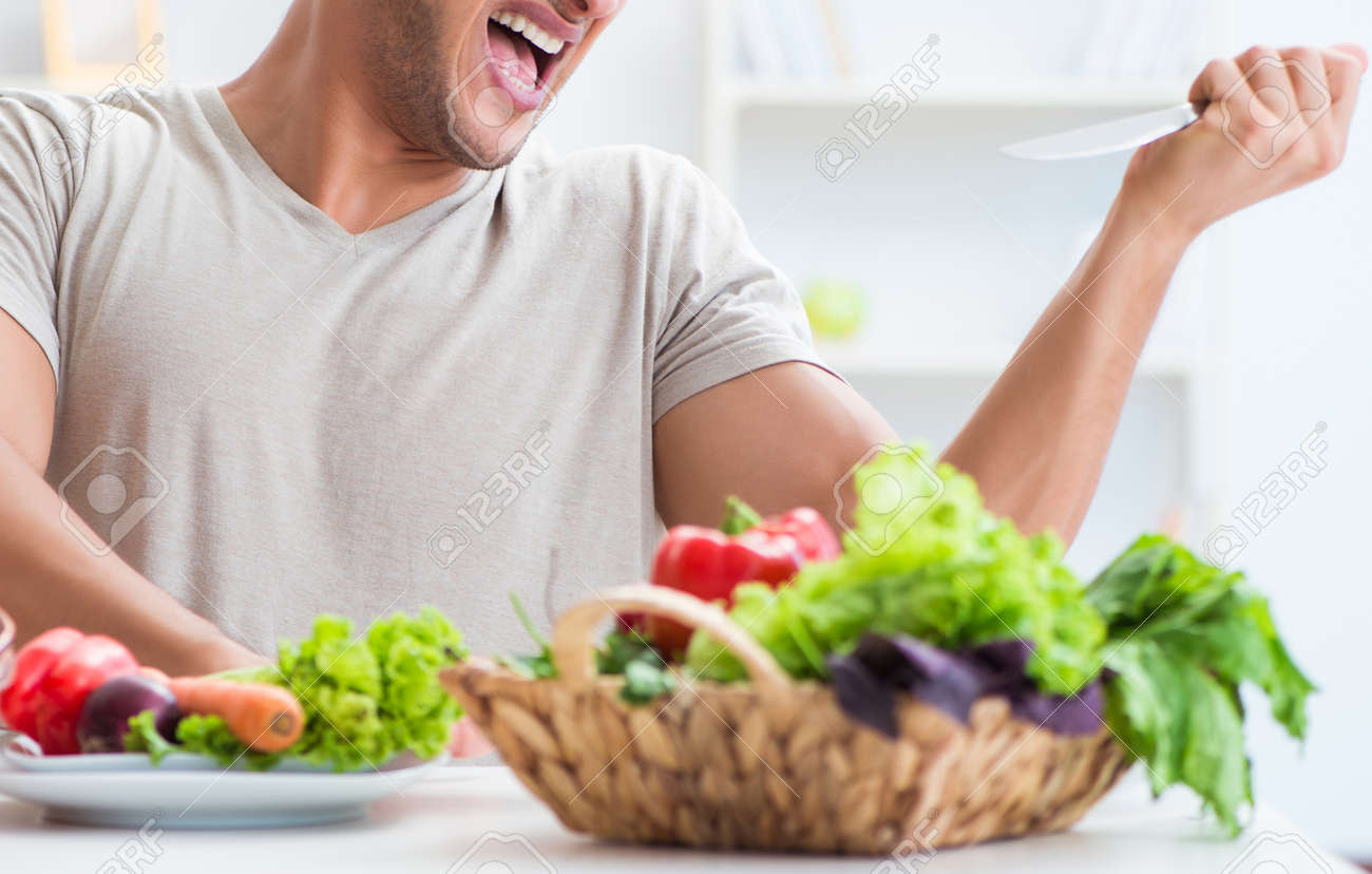 Young man in healthy eating and dieting concept - 131396954