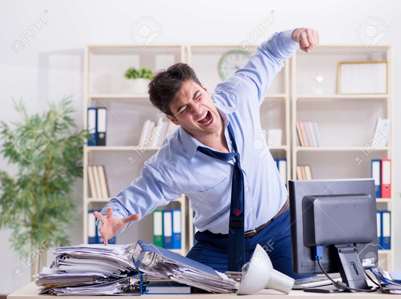 Angry businessman frustrated with too much work - 131877943