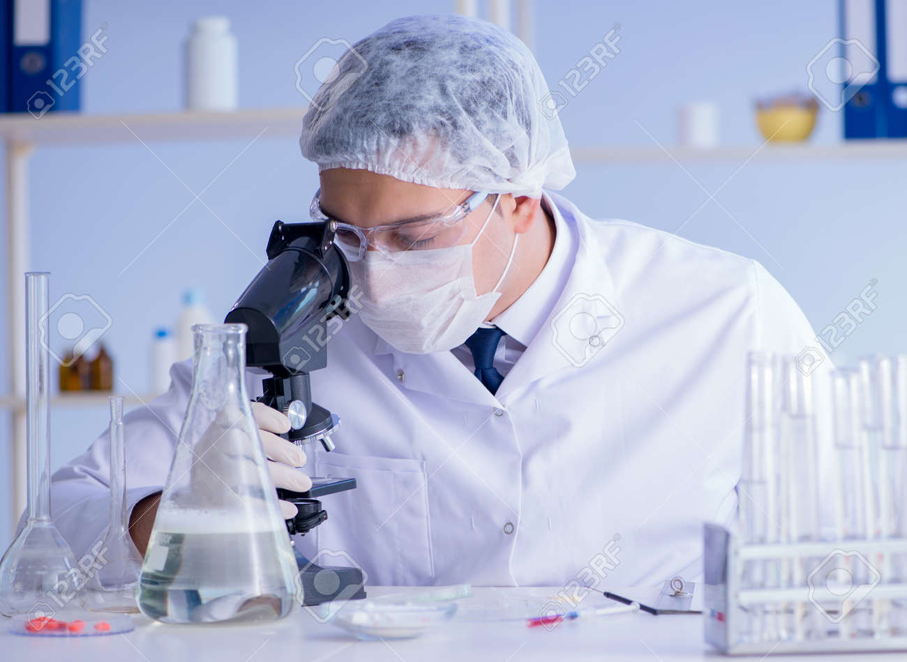 The man in the lab testing new cleaning solution detergent - 135220263
