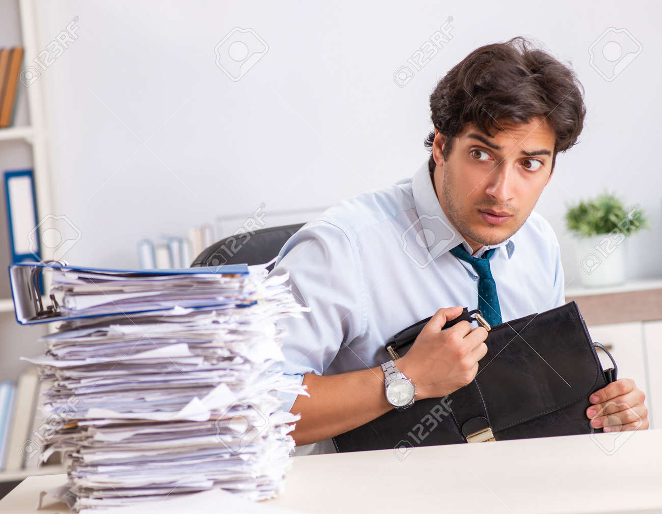 Overloaded busy employee with too much work and paperwork - 146487366