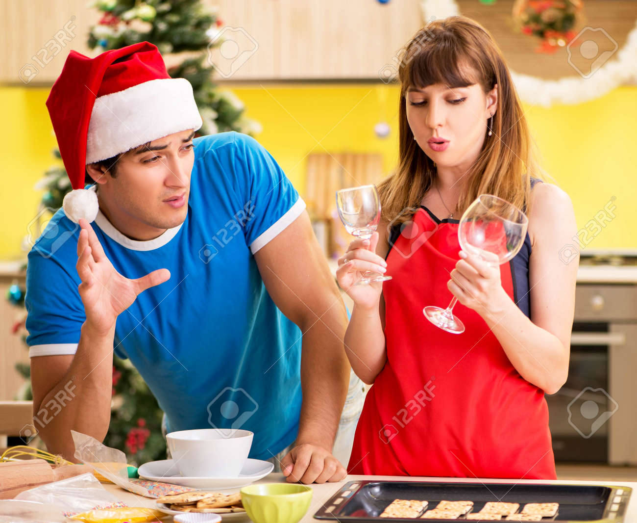 Young couple celebrating Christmas in kitchen - 146457700