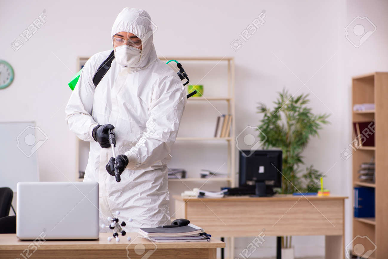 Contractor disinfecting office for COVID-19 coronavirus - 146881690