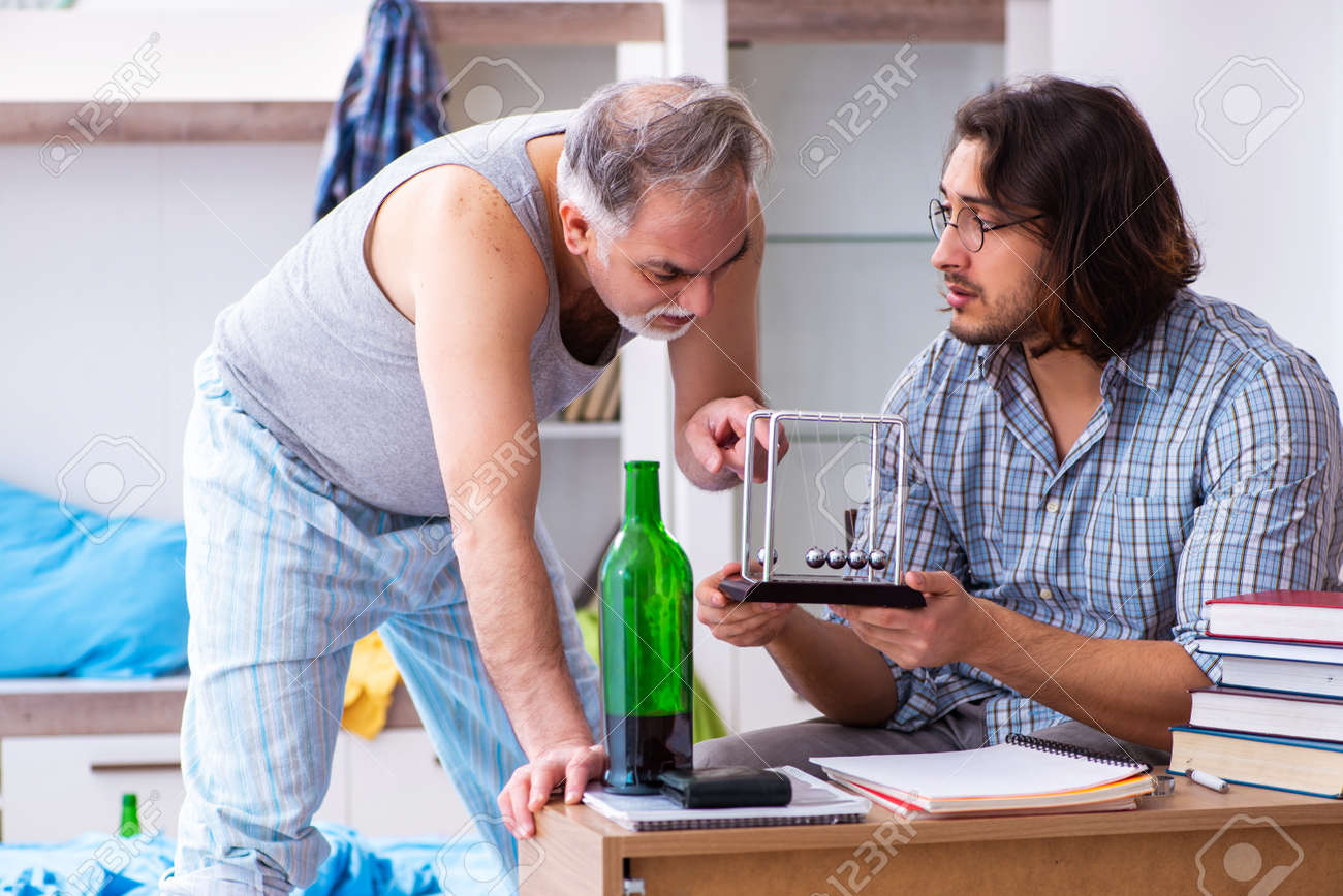 Young son student and dad alcoholic - 154338517