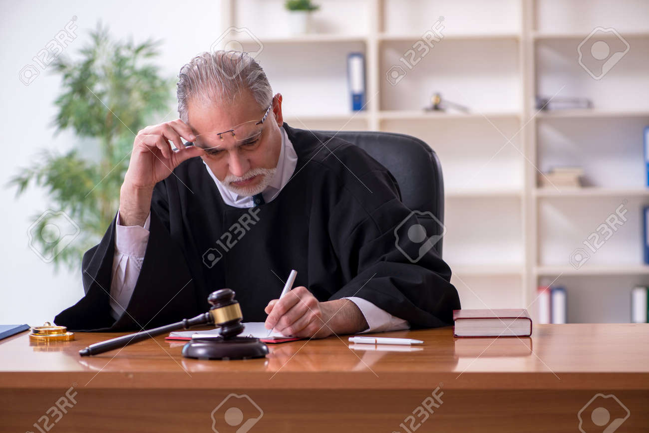 Old male judge working in courthouse - 155162343