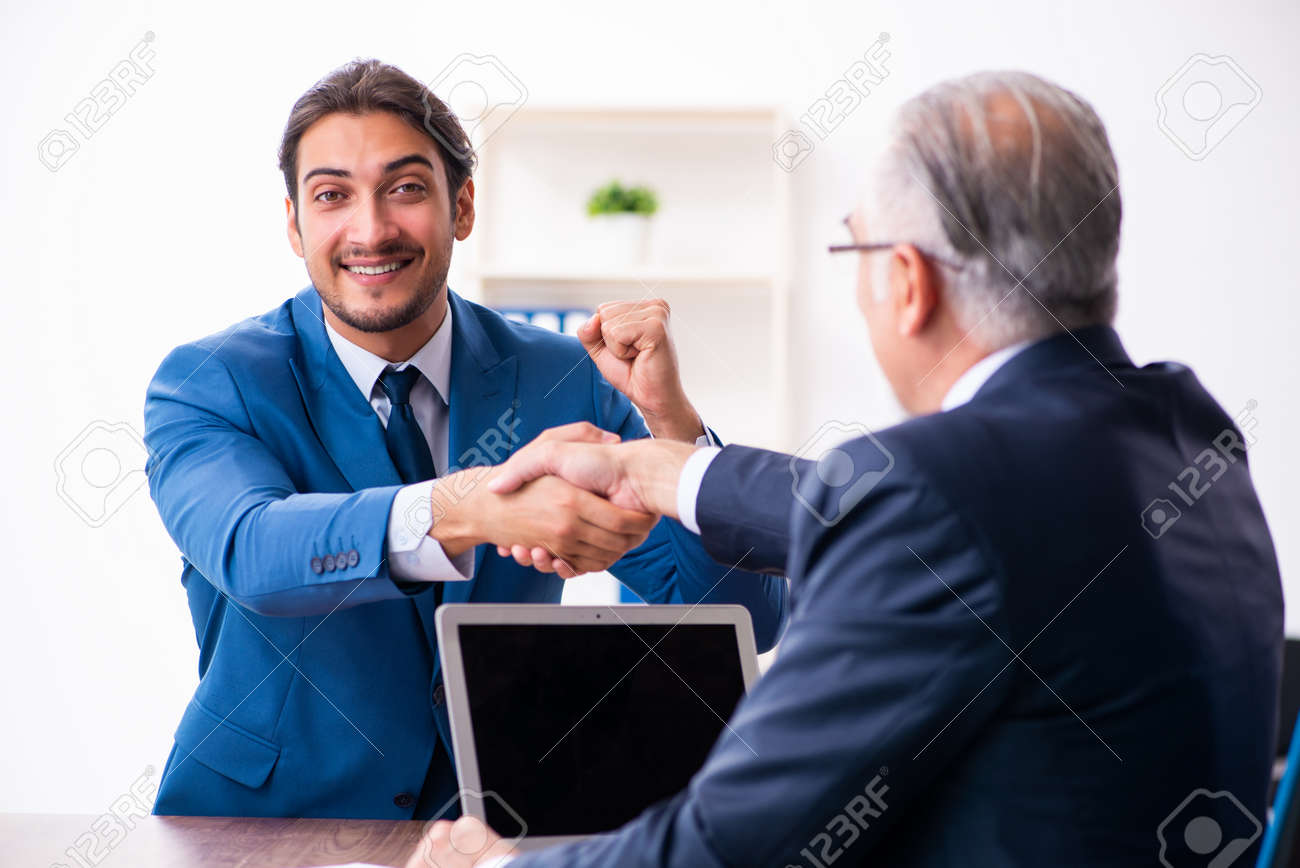 Young male candidate employee meeting with old recruiter - 157746528