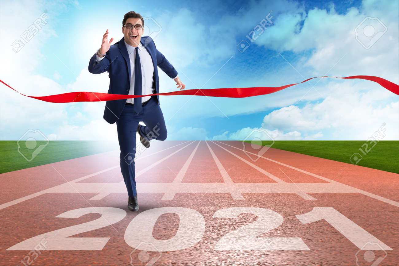 Businessman on finish line to year 2021 - 158723731