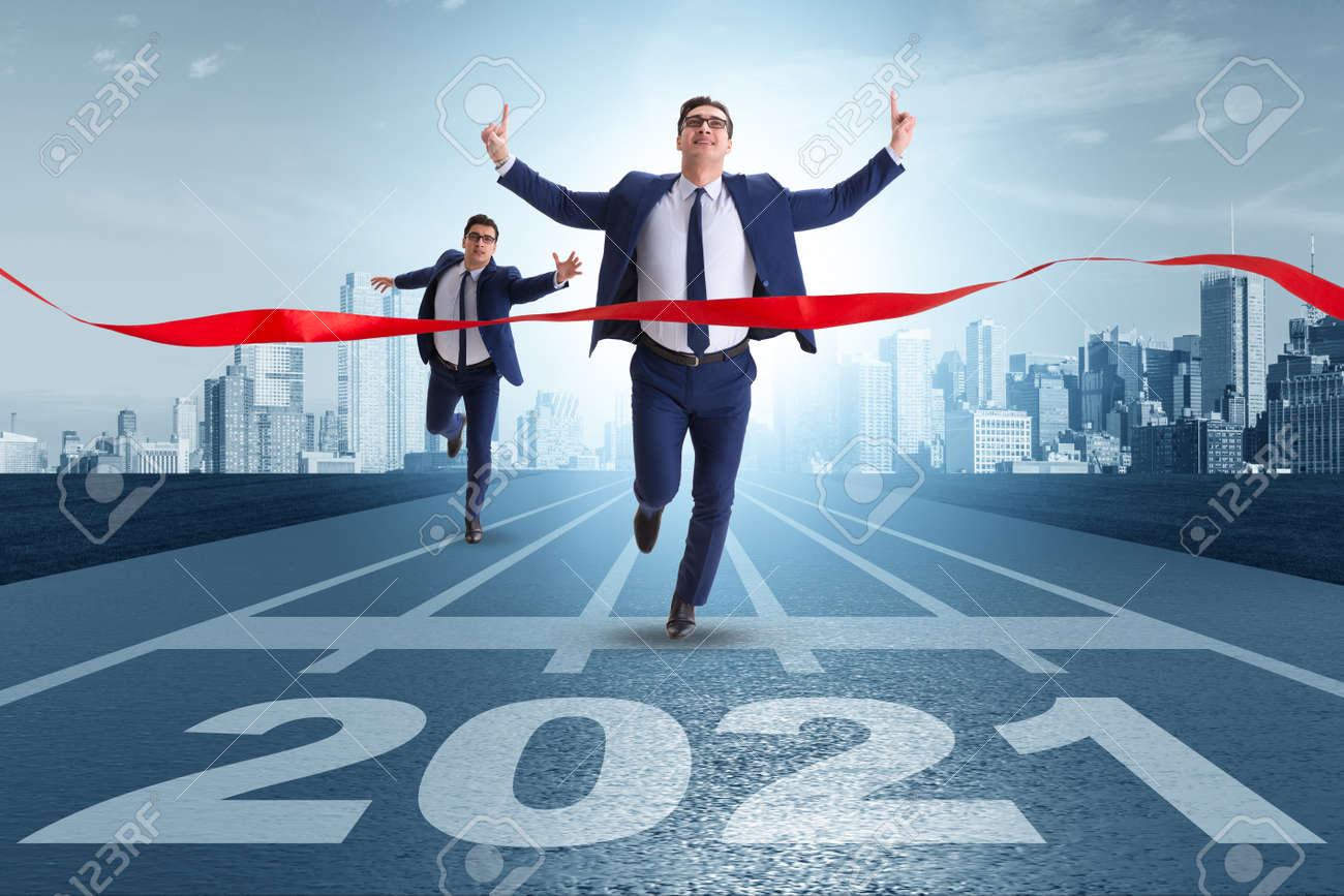 Businessman on finish line to year 2021 - 159257577