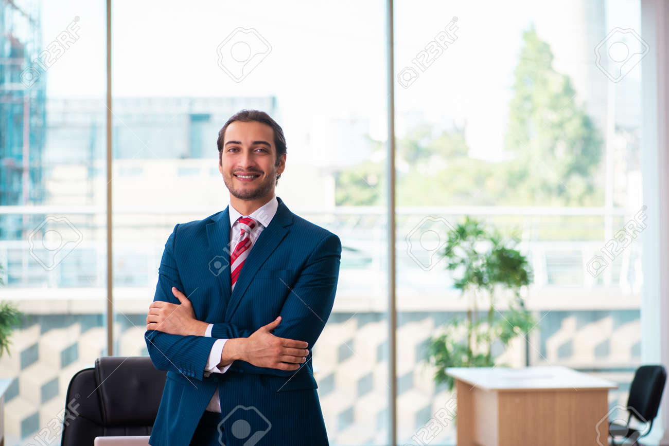 Young handsome employee working in the office - 159849199