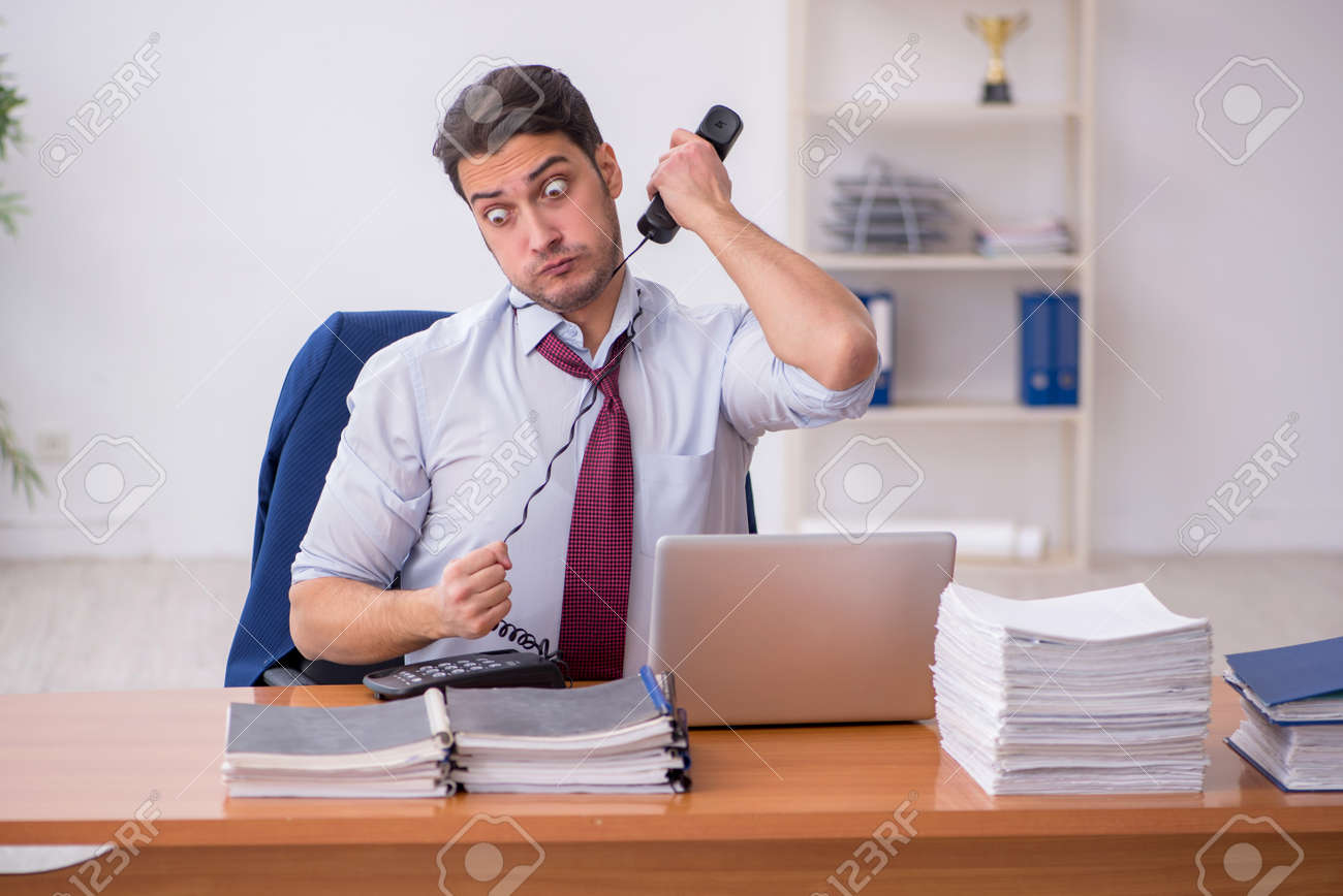 Young businessman and too much work in the office - 167888154