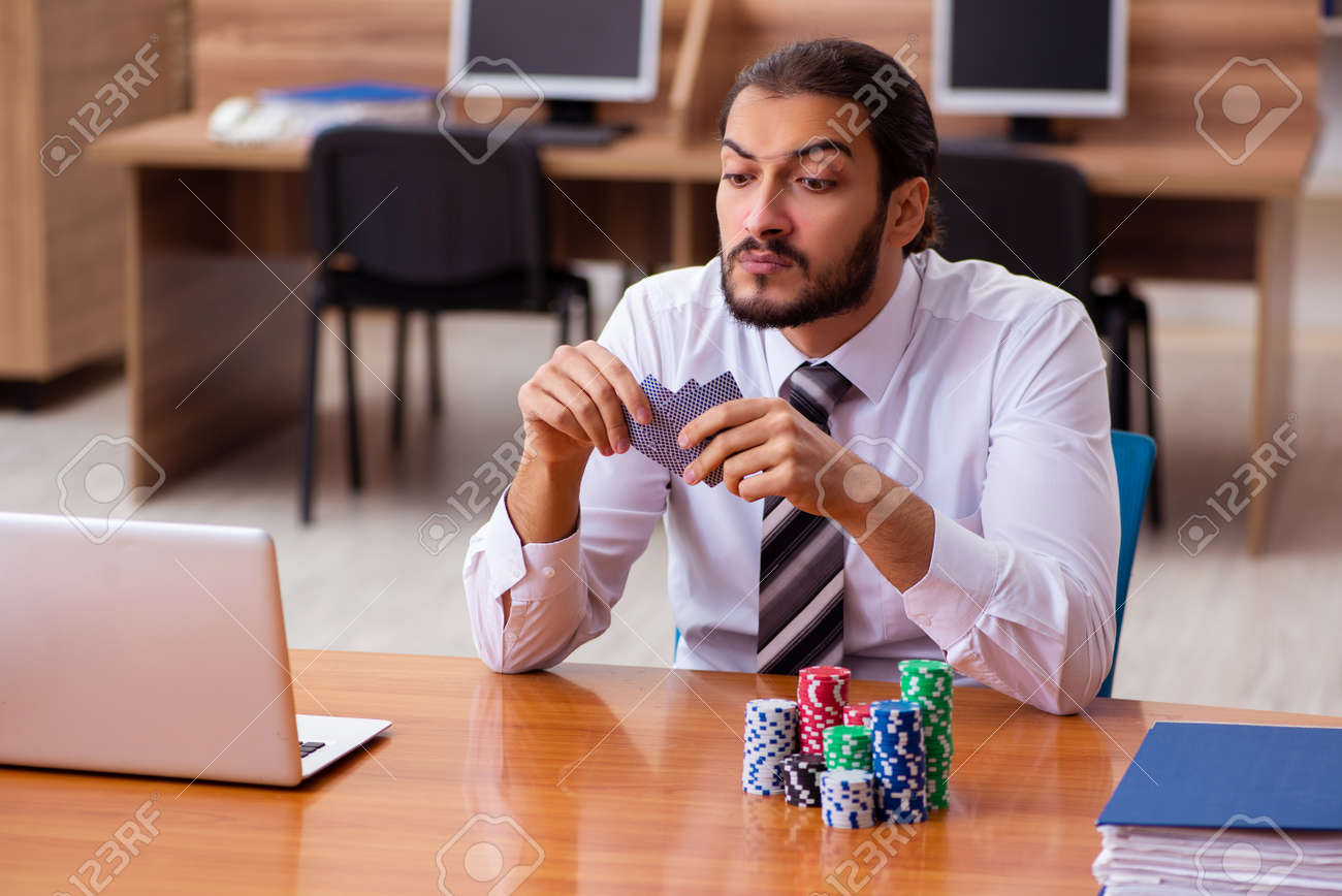 Young male employee in gambling concept - 168015037