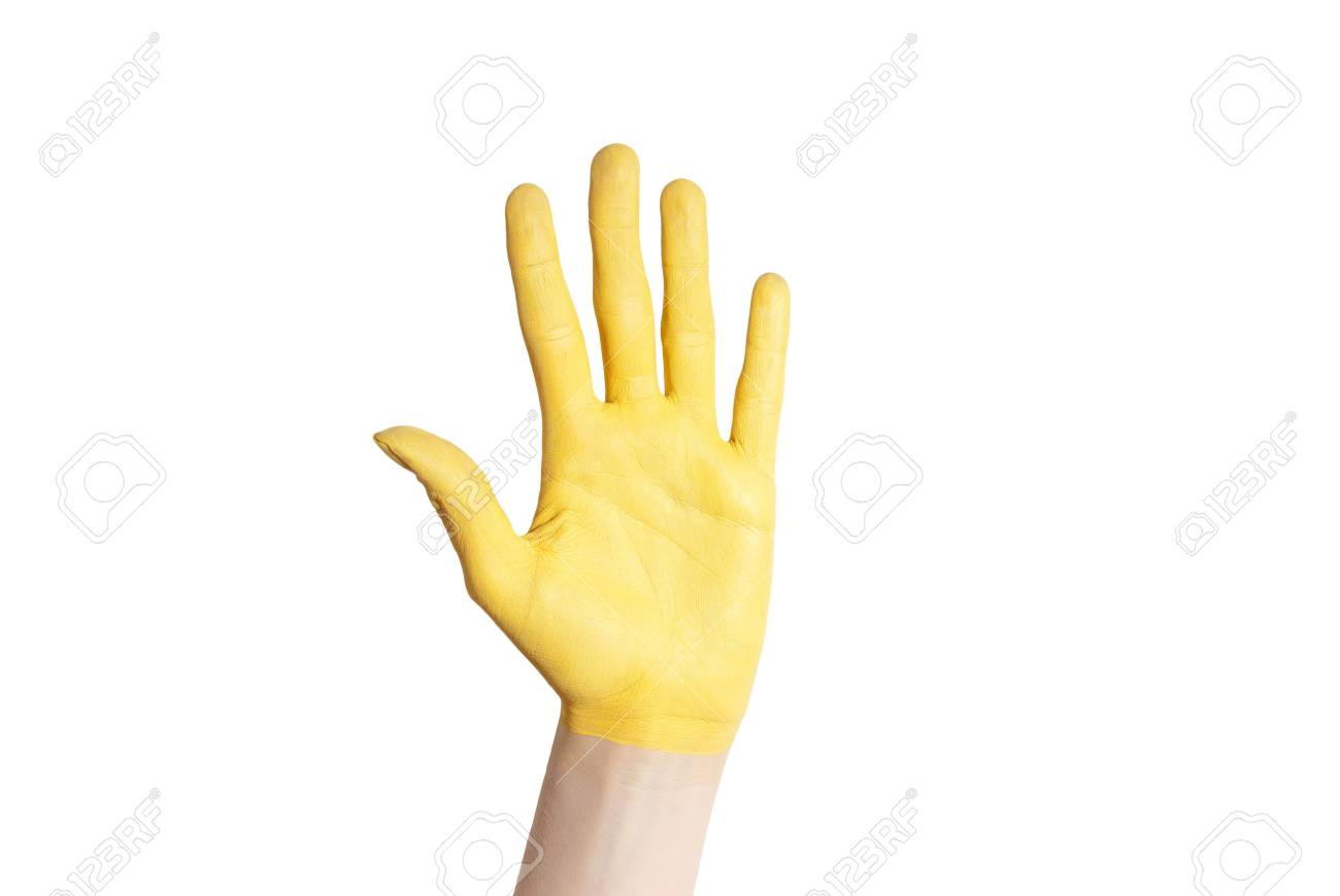 a yellow hand in voting gesture or as a symbol of luck and happiness Stock Photo - 18181401
