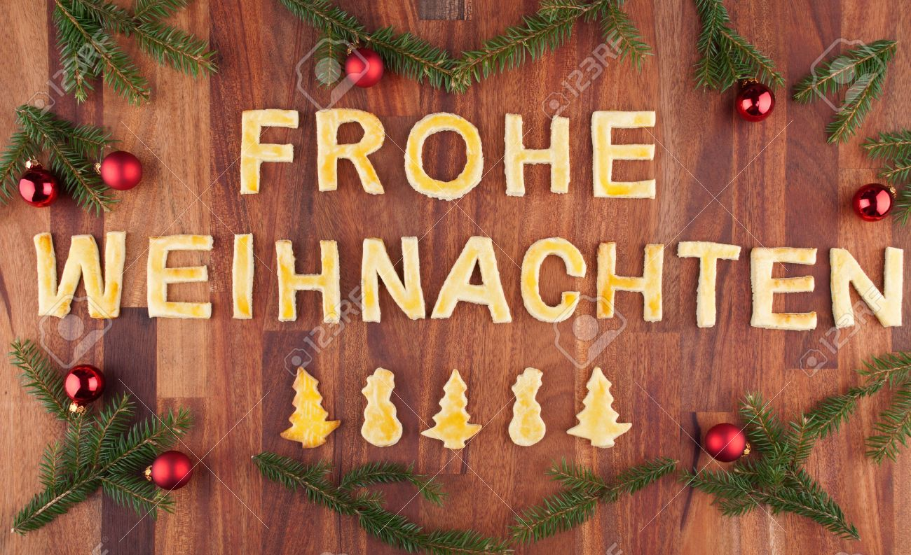 German christmas tree ornaments - Stock Photo The German Words Frohe Weihnachten Which Means Merry Christmas With Christmas Decorations