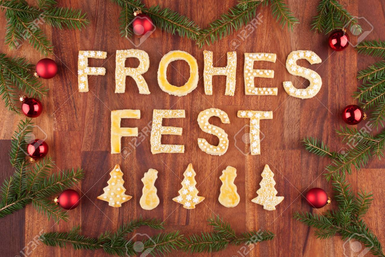 German christmas tree ornaments - Stock Photo The German Words Frohes Fest Which Means Merry Christmas With Christmas Decorations And Cookies