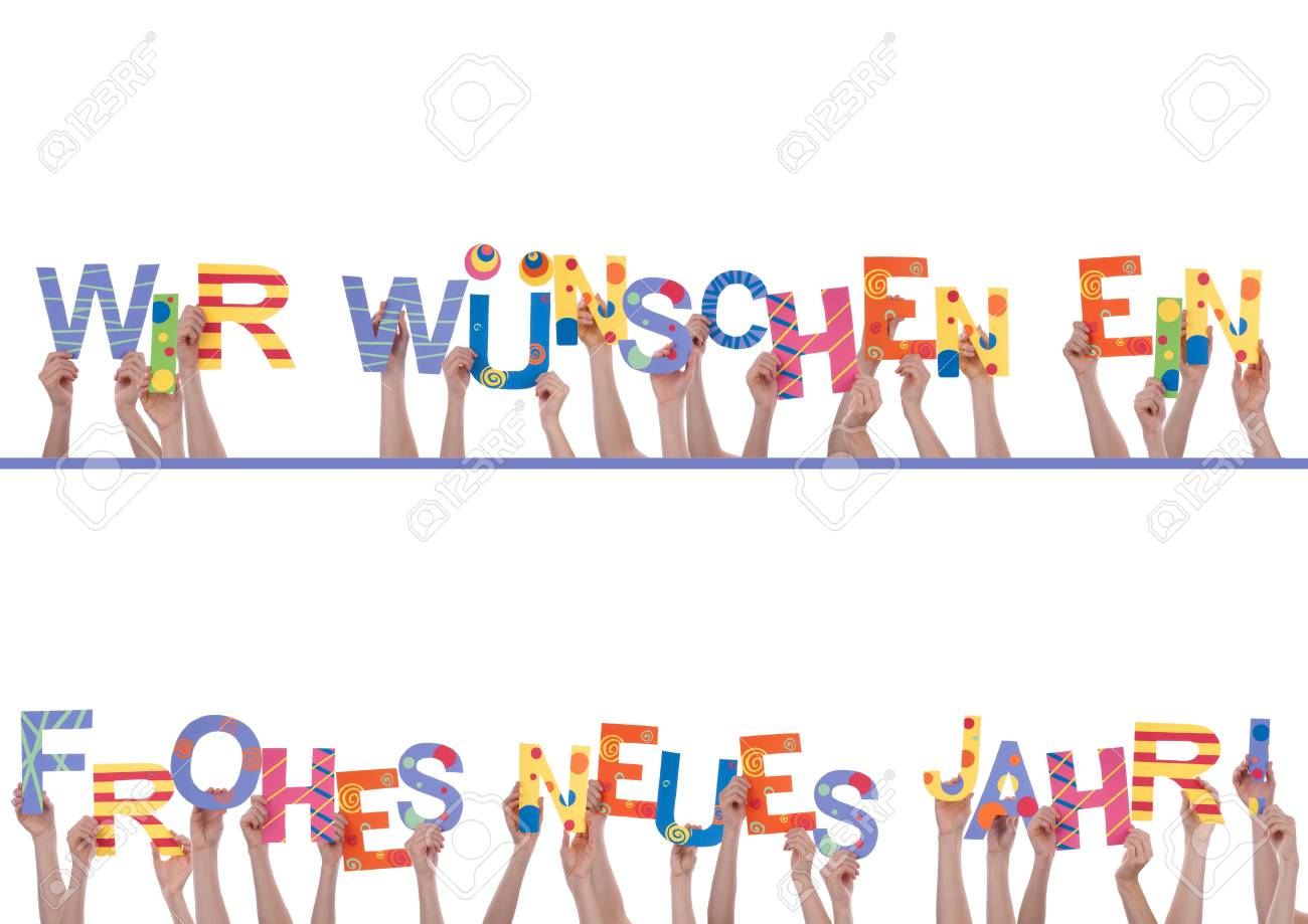 Many Hands Holding the Colorful German Words Wir Wuenschen Ein Frohes Neues Jahr, Which Means We Wish A Happy New Year, Isolated Stock Photo - 23388830