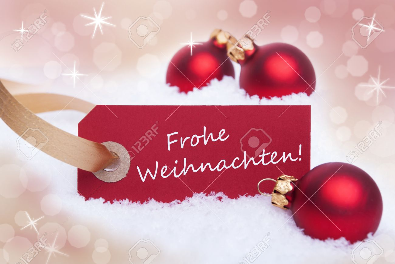 A Red Tag With The German Words Frohe Weihnachten Which Means ...