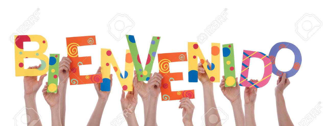 Many Hands Holding The Colorful Spanish Word Bienvenido, Which ...