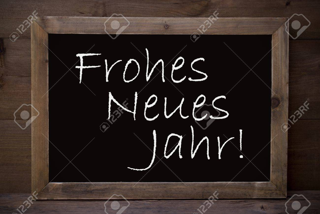 Brown Blackboard With German Text Frohes Neues Jahr Means Happy ...