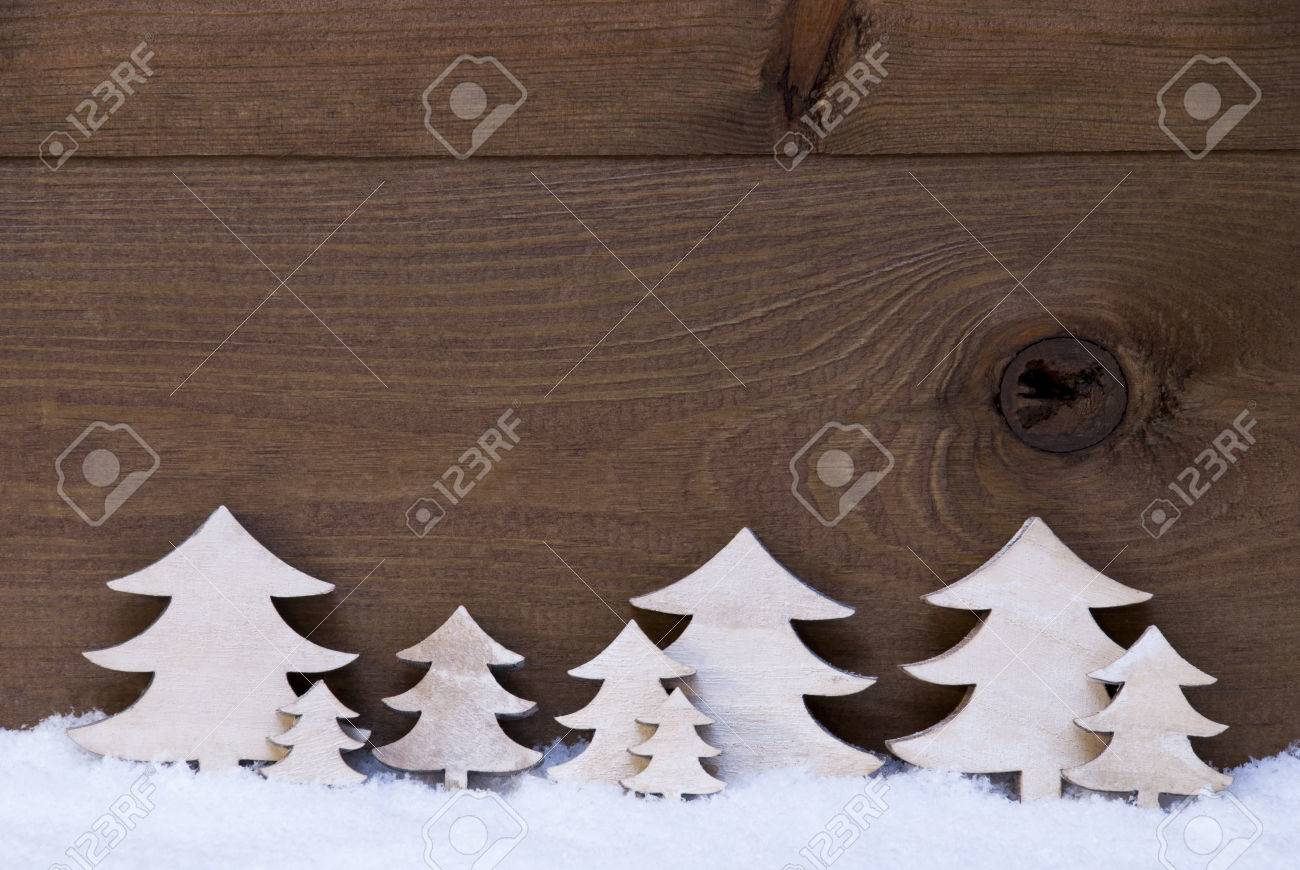 White Wooden Christmas Trees On Snow. Christmas Decoration Or ...