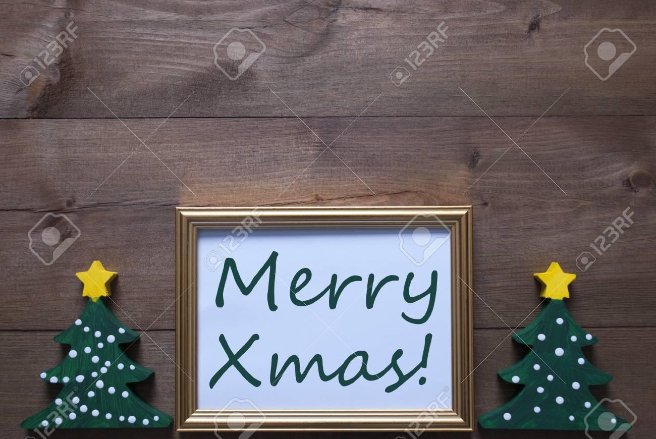 Ein Goldener Bilderrahmen Mit Zwei Grünen Weihnachtsbaum. Englisch ...