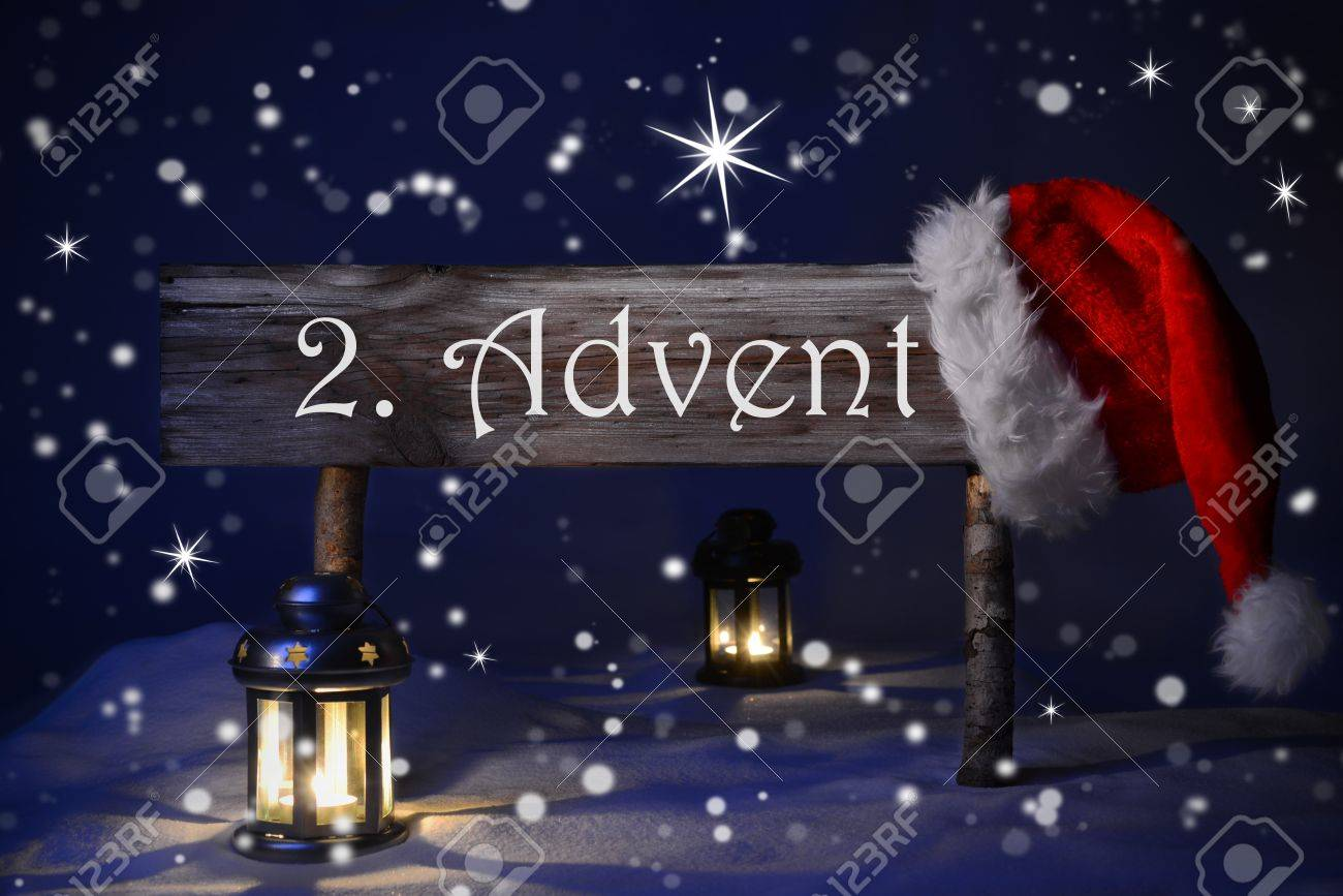 Wooden christmas sign and santa hat with snow in snowy scenery advent means christmas time for seasons greetings blue silent night snowflakes sparkling stars lantern and candlelight m4hsunfo