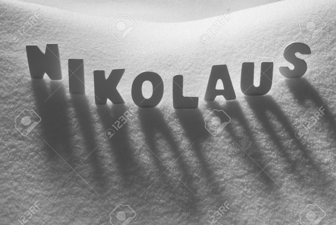 White letters building german text nikolaus means st nicholas white letters building german text nikolaus means st nicholas on white snow snowy landscape or kristyandbryce Images