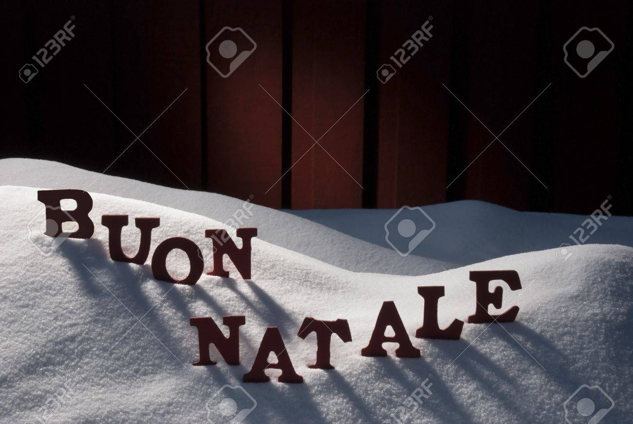 Red Letters On White Snow As Christmas Card Italian Text Or Stock
