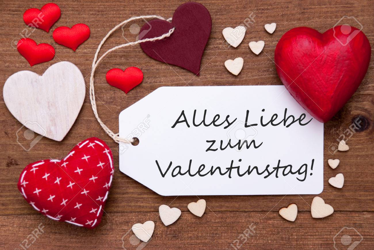 Label With Red Textile Hearts On Wooden Background. German Text Alles Liebe  Zum Valentinstag Means