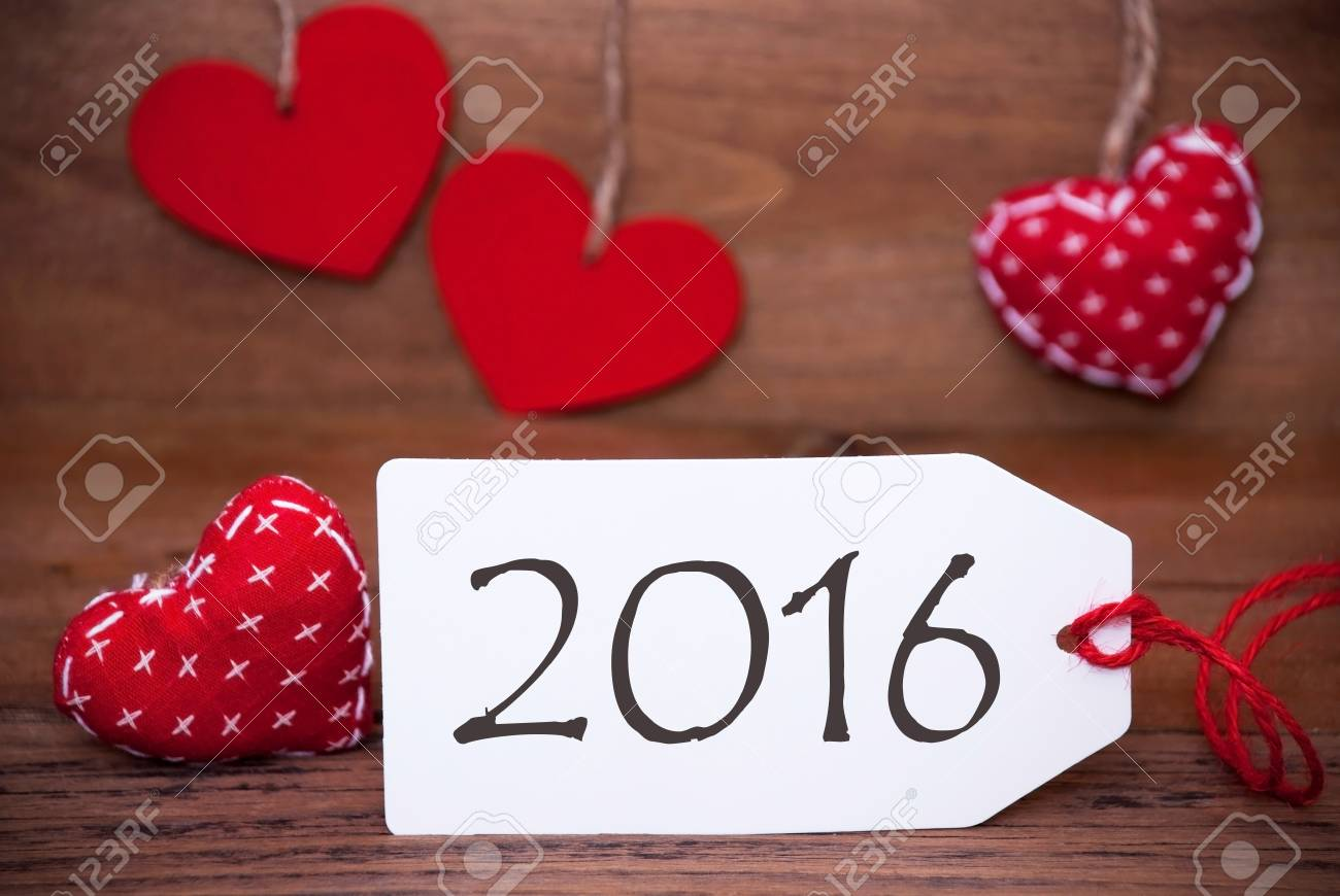one white label with text 2016 for happy new year greetings romantic decoration with red