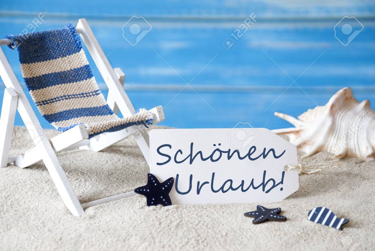 Summer label with german text schoenen urlaub means happy holiday stock photo summer label with german text schoenen urlaub means happy holiday blue wooden background card with holiday greetings m4hsunfo
