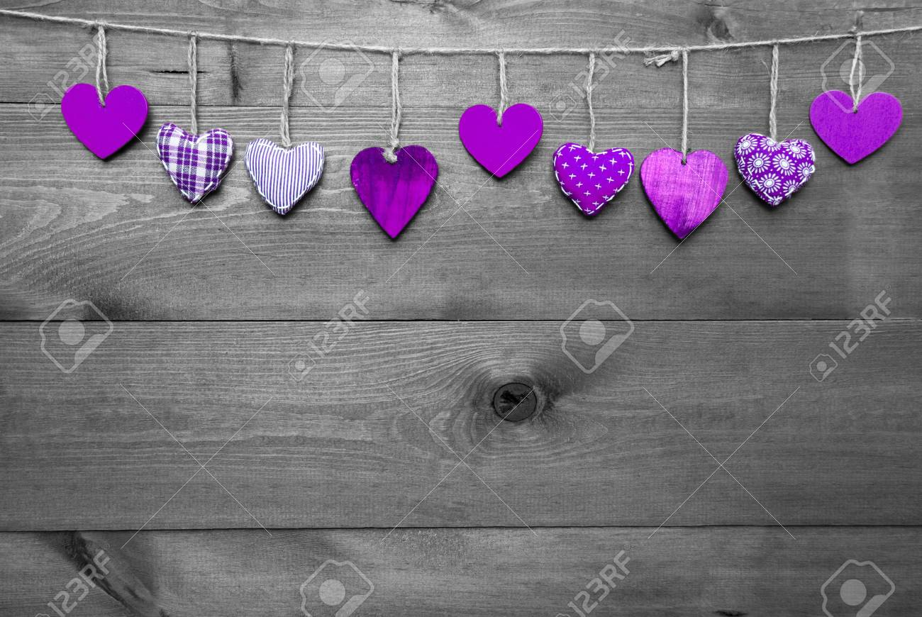 56860962 wooden background with purple hearts hanging in a row black and white style with colored hot spots c jpg